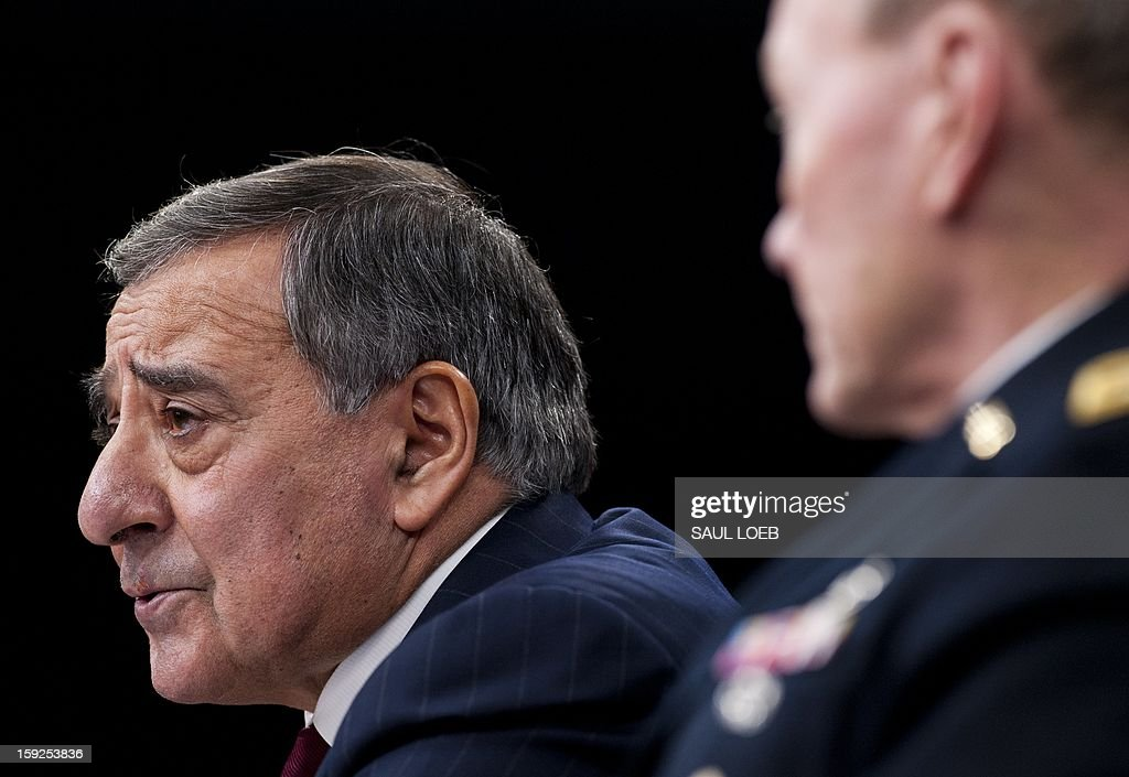US Secretary of Defense Leon Panetta speaks alongside Chairman of the Joint Chiefs of Staff Martin Dempsey (R) during a press conference at the Pentagon in Washington, DC, on January 10, 2013. The United States is increasingly focused on how to secure Syria's chemical weapons if President Bashar al-Assad falls from power but is not considering sending ground troops, Panetta said. AFP PHOTO / Saul LOEB