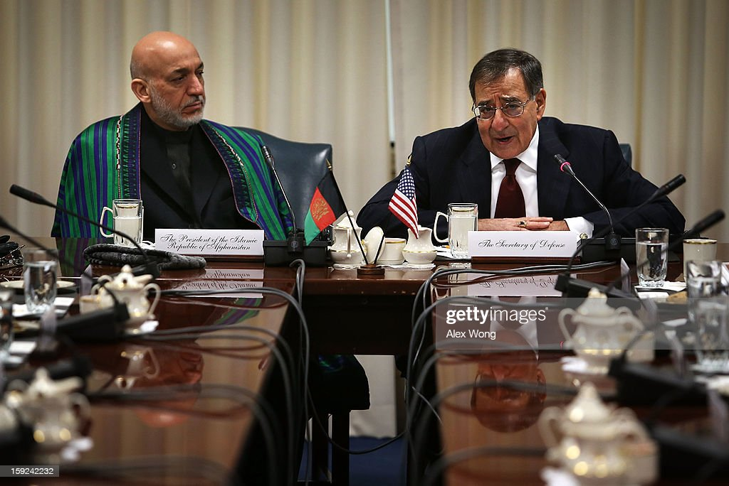 U.S. Secretary of Defense Leon Panetta (R) speaks as Afghan President <a gi-track='captionPersonalityLinkClicked' href=/galleries/search?phrase=Hamid+Karzai&family=editorial&specificpeople=121540 ng-click='$event.stopPropagation()'>Hamid Karzai</a> listens during a meeting at the Pentagon January 10, 2013 in Arlington, Virginia. Karzai is on a visit in Washington, to include a meeting with U.S. President Barack Obama at the White House, to discuss the continued transition in Afghanistan and the partnership between the two nations.