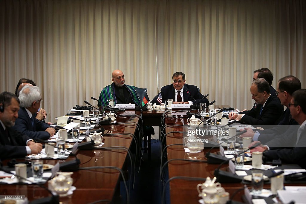 U.S. Secretary of Defense Leon Panetta (R) speaks as Afghan President <a gi-track='captionPersonalityLinkClicked' href=/galleries/search?phrase=Hamid+Karzai&family=editorial&specificpeople=121540 ng-click='$event.stopPropagation()'>Hamid Karzai</a> (L) listens during a meeting at the Pentagon January 10, 2013 in Arlington, Virginia. Karzai is on a visit in Washington, to include a meeting with U.S. President Barack Obama at the White House, to discuss the continued transition in Afghanistan and the partnership between the two nations.