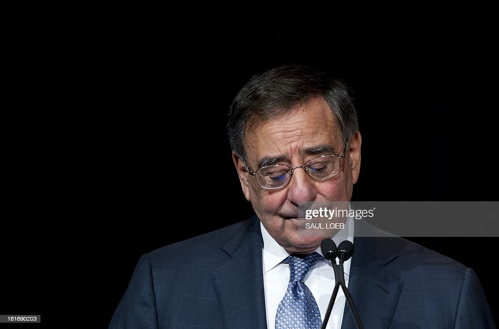 US Secretary of Defense Leon Panetta speaks prior to presenting former Secretary of State Hillary Clinton with the Department of Defense Medal for Distinguished Public Service during a ceremony at the Pentagon in Washington, DC, February 14, 2013. AFP PHOTO / Saul LOEB