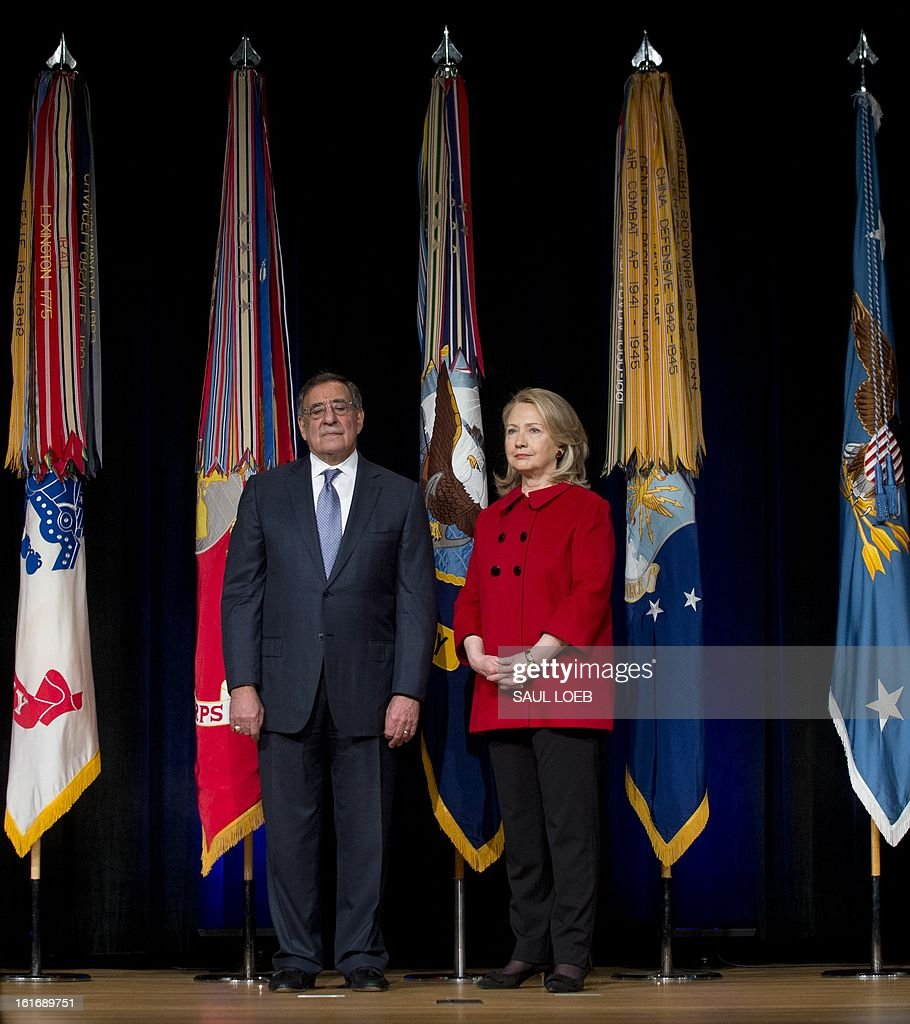 US Secretary of Defense Leon Panetta stands alongside former Secretary of State Hillary Clinton prior to presenting her with the Department of Defense Medal for Distinguished Public Service during a ceremony at the Pentagon in Washington, DC, February 14, 2013. AFP PHOTO / Saul LOEB