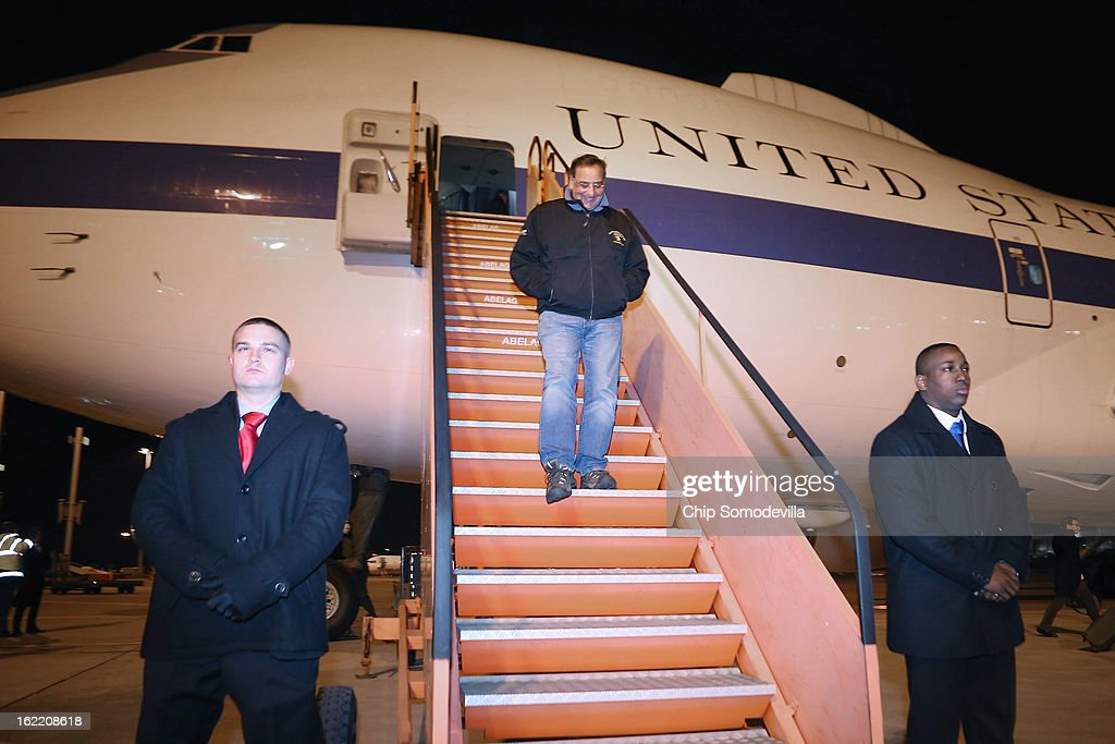 U.S. Secretary of Defense Leon Panetta (C) steps off the E-4B aircraft after landing February 20, 2013 in Brussels, Belgium. Panetta is in Brussels for a meeting of NATO defense ministers.