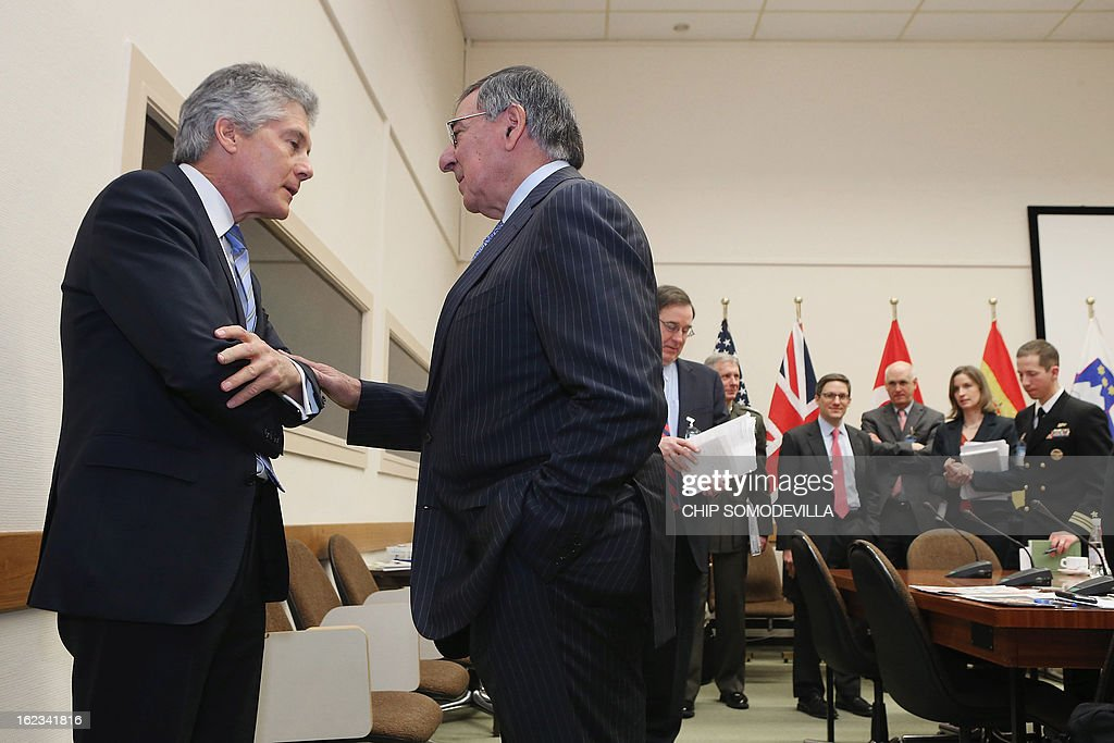US Secretary of Defense Leon Panetta (R) talks to Australian Defense Minister Stephen Smith before a meeting during the North Atlantic Treaty Organization (NATO) Defense Ministers Meetings at NATO headquarters on February 22, 2013 in Brussels, Belgium. Panetta is attending meetings and holding bilateral meetings with other NATO defense officials.