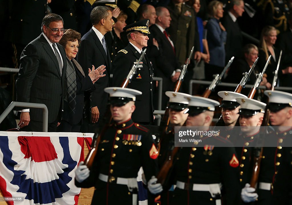 Secretary of Defense Leon Panetta (L) watches soldiers pass by while flanked by his wife Sylvia (2nd L), U.S. President Barack Obama (C) and U.S. Army Gen. Martin E. Dempsey (R), chairman of the Joint Chiefs of Staff during an Armed Service farewell ceremony for Sec. Panetta at Joint Base Ft. Myer, on February 8, 2013 in Arlington, Virginia. If confirmed by the U.S. Senate former U.S. Senator Chuck Hagel (R-NE),will replace Mr. Panetta as Defense Secretary.