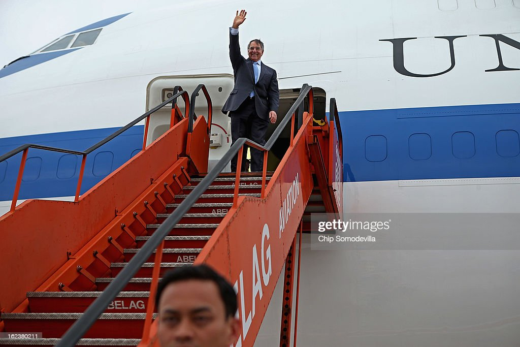 U.S. Secretary of Defense Leon Panetta waves goodbye before boarding his aircraft and departing February 22, 2013 in Brussels, Belgium. Panetta attended the North Atlantic Treaty Organization (NATO) Defense Ministers Meetings at NATO headquarters.