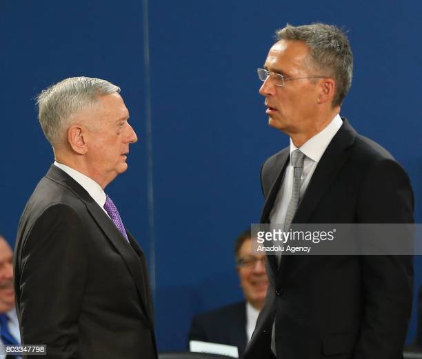 Secretary of Defense Minister James Mattis talks with NATO Secretary General Jens Stoltenberg during a NATO Defence Council meeting at the NATO...