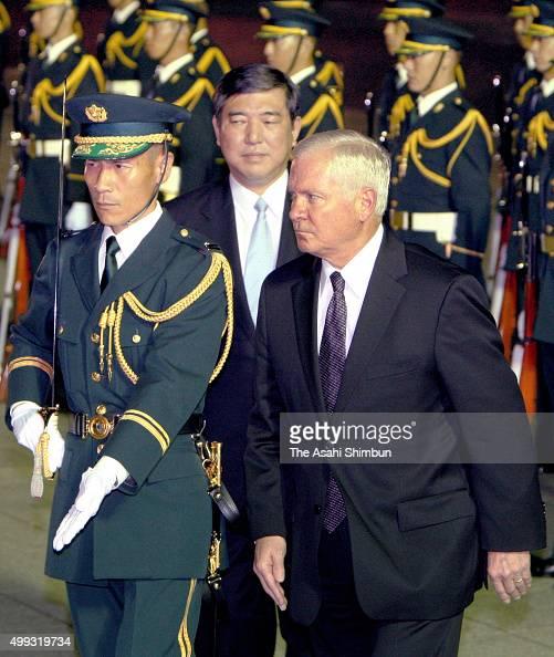 US Secretary of Defense Robert Gates and Japanese Defense Minister Shigeru Ishiba review an honour guard at Defense Ministry on November 8 2007 in...