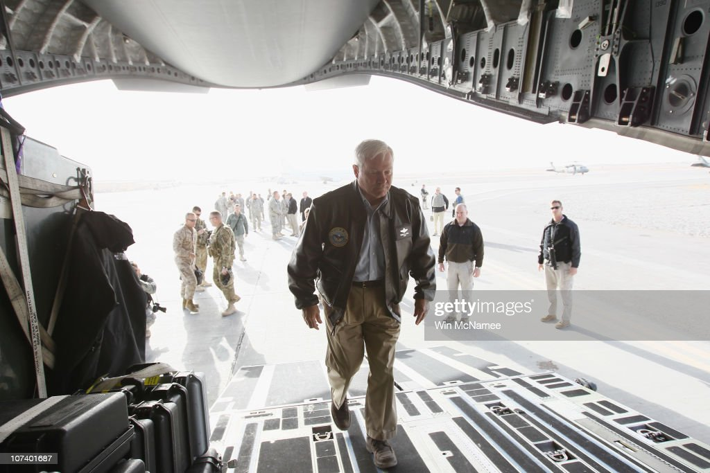U.S. Secretary of Defense Robert Gates (C)) boards a C-17 after visiting U.S. troops at Forward Operating Base Howz-E-Madad in Kandahar Province December 8, 2010 in Afghanistan. Gates is visiting U.S. soldiers in different operational areas of Afghanistan during his visit.