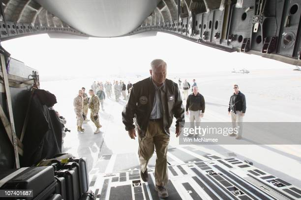 S Secretary of Defense Robert Gates boards a C17 after visiting US troops at Forward Operating Base HowzEMadad in Kandahar Province December 8 2010...