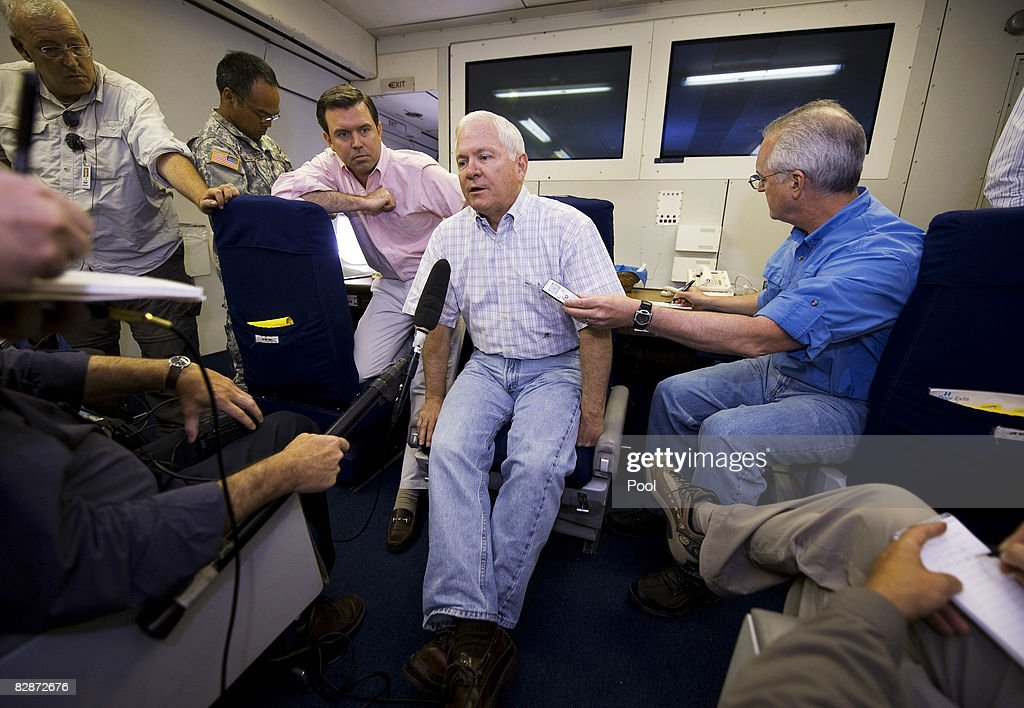 U.S. Secretary of Defense Robert Gates (C) conducts a question and answer session with Pentagon reporters aboard a USAF 747-E4B airborne command post September 14, 2008 while over the Atlantic Ocean enroute to Incirlik Air Force Base in Turkey.