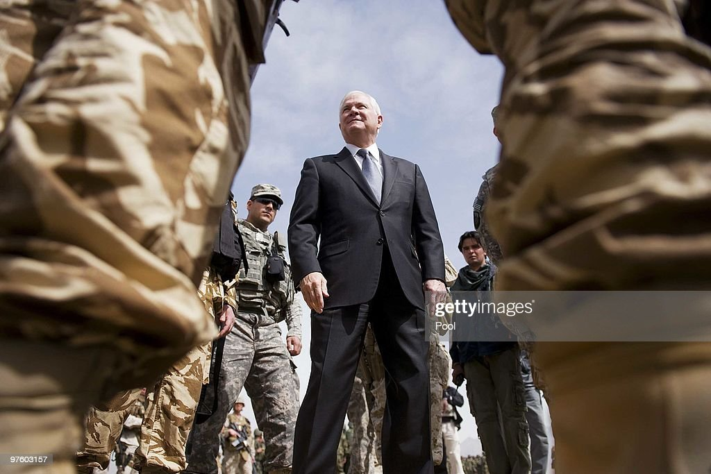 US Secretary of Defense Robert Gates (C) inspects troops as he tours Camp Blackhorse training grounds on March 10, 2010 in Kabul, Afghanistan. During his tour of Afghanistan, US Defence Secretary Gates said he was convinced the war effort was on course.