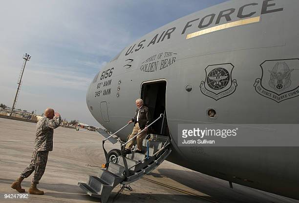 S Secretary of Defense Robert Gates is greeted by US Army Lt General Kenneth Hunzeker after arriving at Baghdad International Airport December 10...