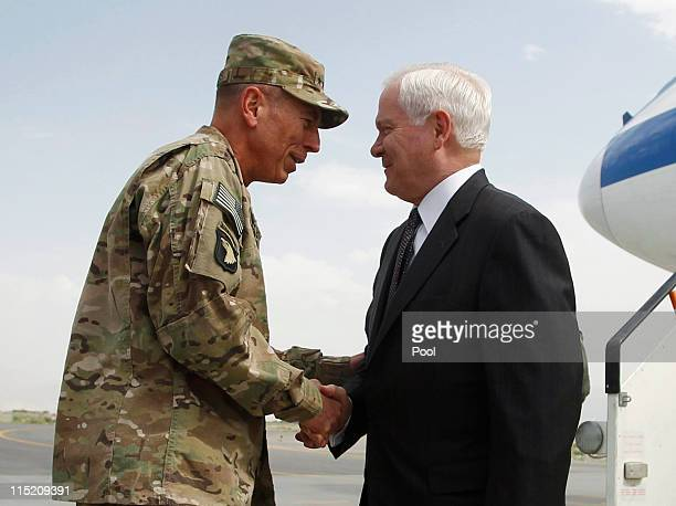 S Secretary of Defense Robert Gates is greeted upon his arrival by US General David Petraeus Commander of International Forces in Afghanistan on June...