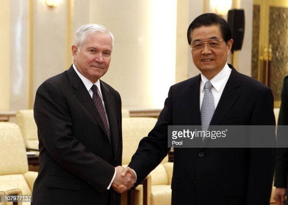 S Secretary of Defense Robert Gates shakes hands with China's President Hu Jintao at the Great Hall of the People on January 11 2011 in Beijing China...