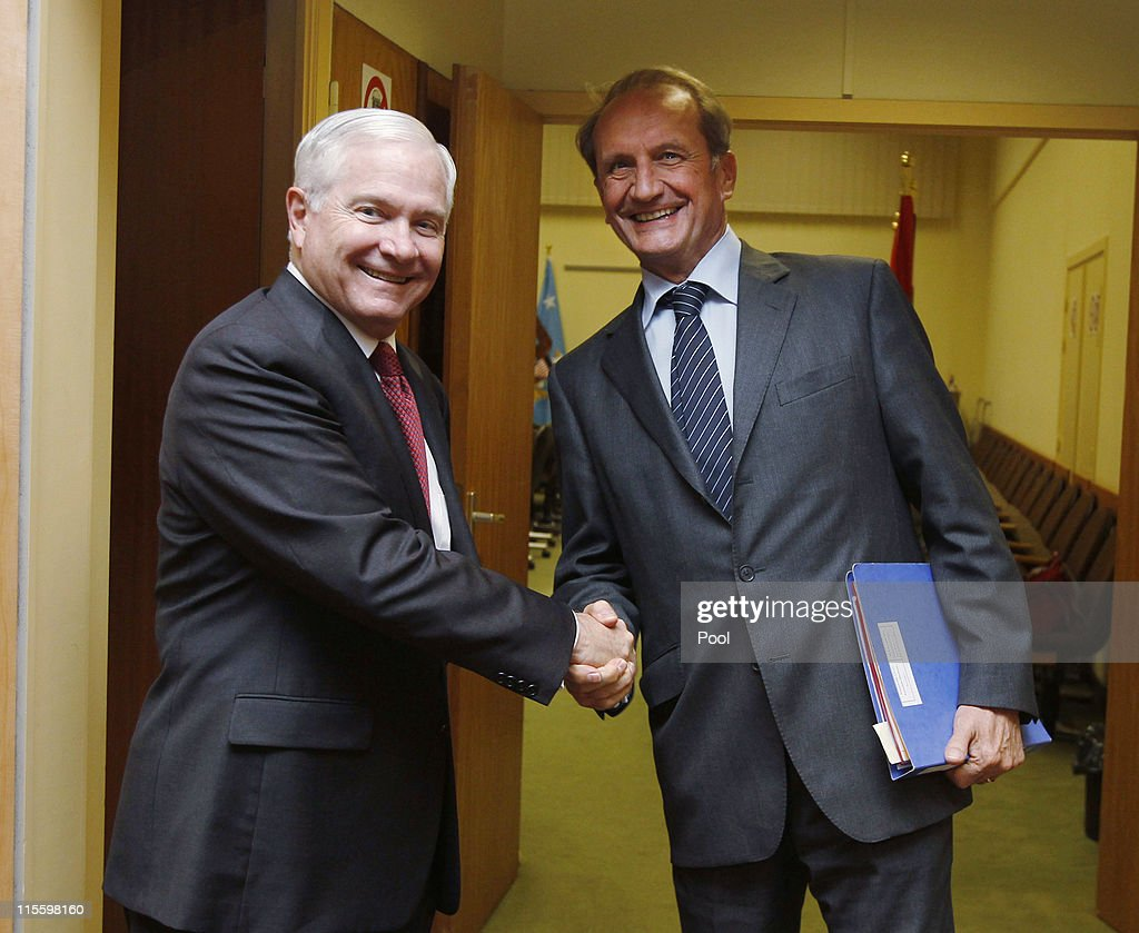 U.S. Secretary of Defense Robert Gates (L) shakes hands with France's Defence Minister <a gi-track='captionPersonalityLinkClicked' href=/galleries/search?phrase=Gerard+Longuet&family=editorial&specificpeople=2528102 ng-click='$event.stopPropagation()'>Gerard Longuet</a> during a meeting of the NATO-Russia Council at the NATO Defence Ministers Summit on June 8, 2011 in Brussels, Belgium. Gates arrived for NATO talks after a two-day farewell trip in Afghanistan before he steps down as U.S. Secretary of Defense.