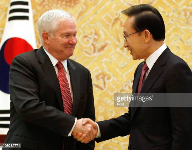 Secretary of Defense Robert Gates shakes hands with the President of the Republic of Korea Lee Myungbak during their meeting at the Blue House on...