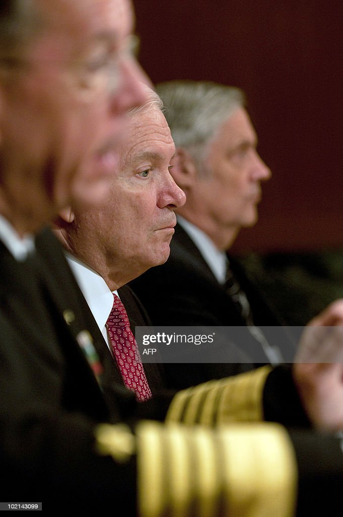 US Secretary of Defense Robert M. Gates (C) Adm. Mike Mullen Chairman of the Joint Chiefs of Staff (L) and Under Secretary of Defense Robert Hale (R) appear before a Senate Appropriations Committee hearing on the proposed budget estimates for FY2011 for the Defense Department, in the Dirksen Senate Office Building on Capitol Hill in Washington, DC, June 16, 2010.
