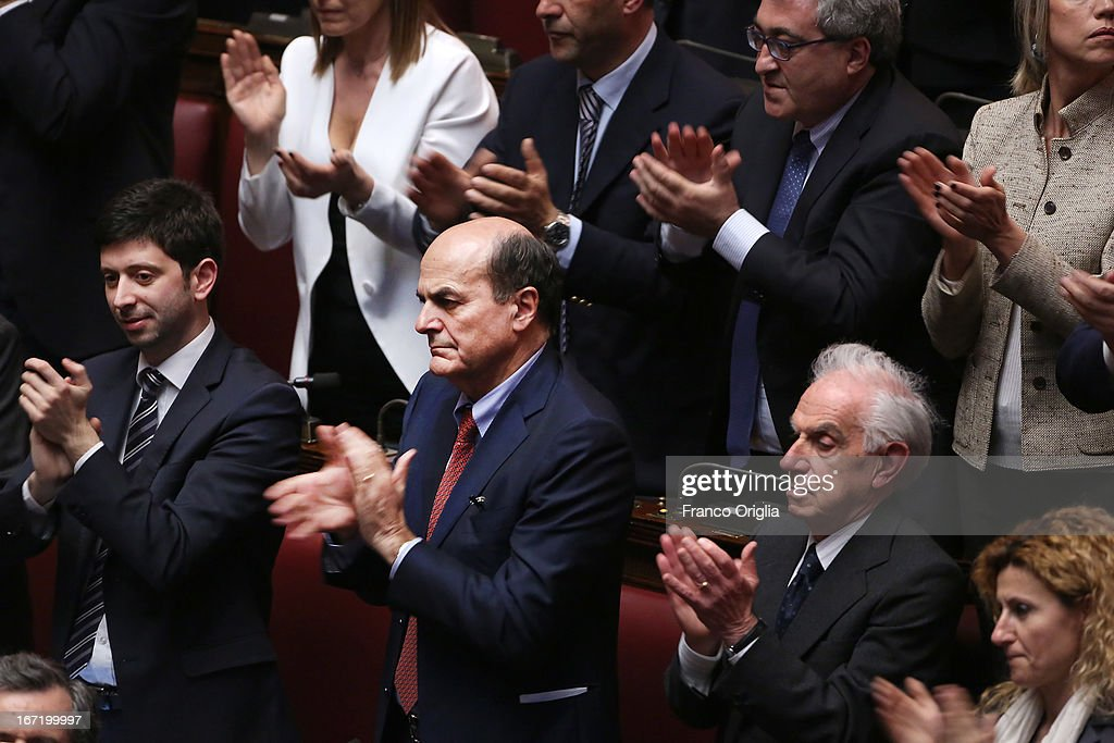 Secretary of Democratic Party Pier Luigi Bersani (2nd L) applauds during the inauguration of the newly reelected President Giorgio Napolitano during a joint session of parliament at Palazzo Montecitorio on April 22, 2013 in Rome, Italy. Napolitano, who is 87 years old, was reelected for a second seven-year term as Italian President on April 19.