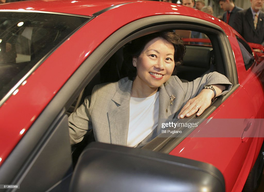 U.S. Secretary of Department of Labor, Elaine Chao, sits in a new 2005 Ford Mustang after it was revealed to the media September 27, 2004 in Flat Rock, Michigan. The event was held to celebrate the launch of the 2005 Ford Mustang at its new home, Auto Alliance International. Ford Motor Company invested approximately $700 million in the new plant's flexible manufacturing system, which includes a new body shop with 380 robots. The new system enables the plant to build six new models on two vehicle platforms.