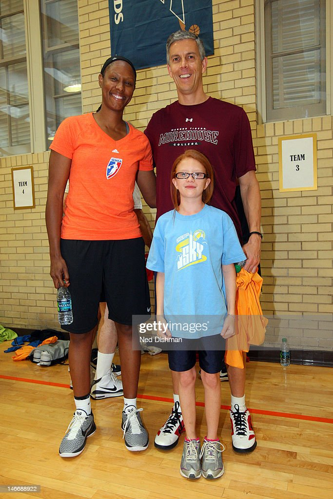S Secretary of Education Arne Duncan and Chamique Holdsclaw pose for a photo after playing basketball Senior Administration Officials and Members of...