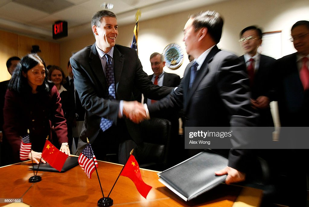 U.S. Secretary of Education Arne Duncan (L) shakes hands with Chinese Minister of Education Zhou Ji (R) after they signed the 2009 U.S.-China Work Plan on Education Activities and the Joint Statement of Exchange and Cooperation in Higher Education during a signing ceremony at the U.S. Department of Education April 16, 2009 in Washington, DC. Education officials of both countries met in Washington to discuss ways to improve education in the United States and China.
