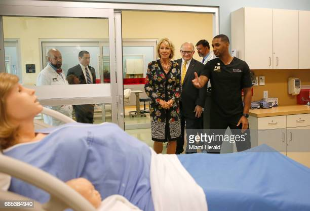 US Secretary of Education Betsy DeVos alongside FIU President Mark B Rosenberg left talks with FIU Support Specialist Frederic Tassy during a tour of...