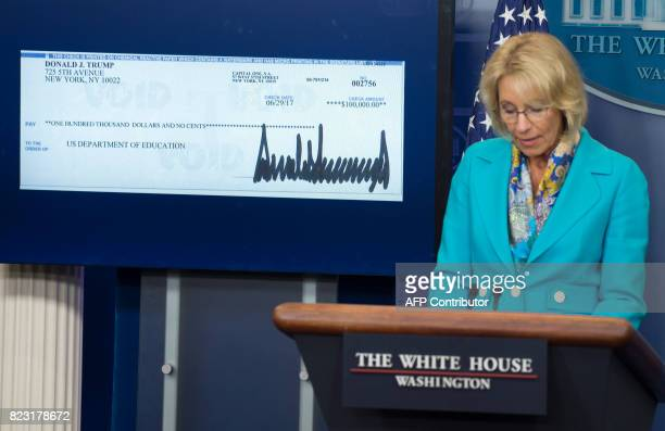 US Secretary of Education Betsy DeVos speaks about a donation from US President Donald Trump to the Department of Education during the daily press...