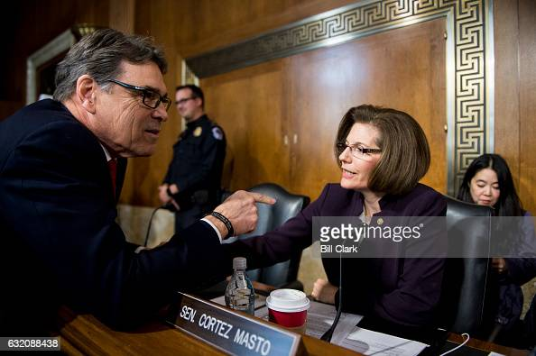 Secretary of Energy nominee former Gov Rick Perry RTexas speaks with Sen Catherine Cortez Masto DNev as he arrives for his confirmation hearing in...