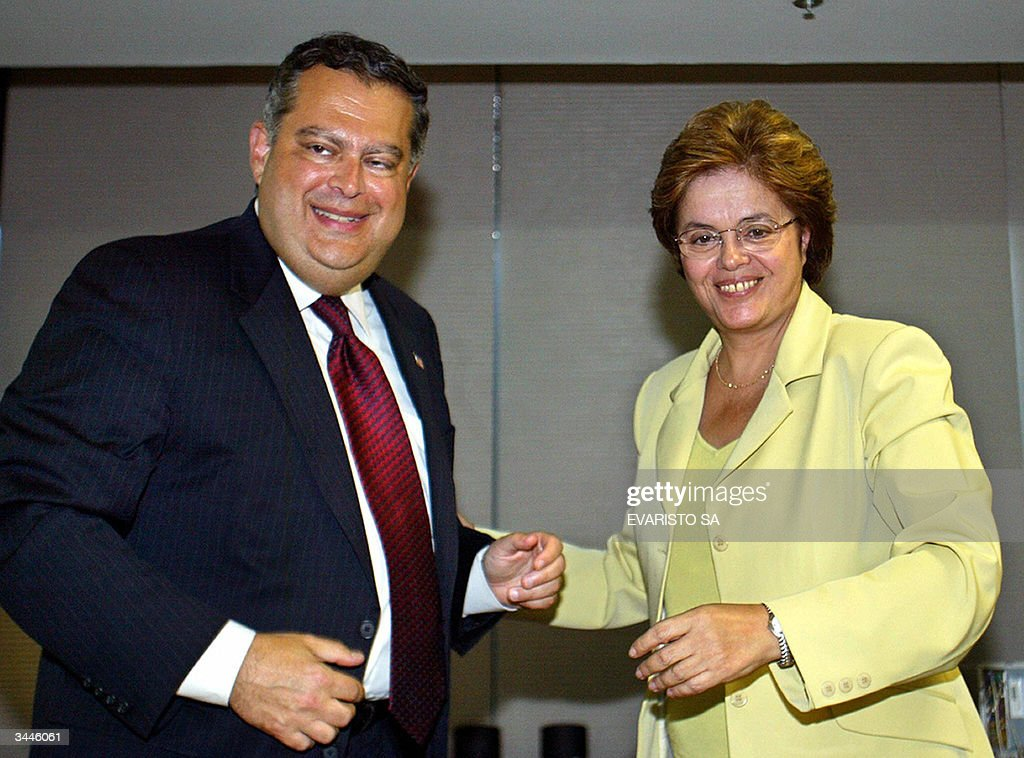 US Secretary of Energy Spencer Abraham (L) and the Brazilian Minister of Mines and Energy Dilma Rousseff, smile prior to a press conference in Brasilia, 19 April 2004. Abraham arrived in Brazil to expand bilateral cooperation and doesn't rule out talks on nuclear energy. AFP PHOTO/Evaristo SA