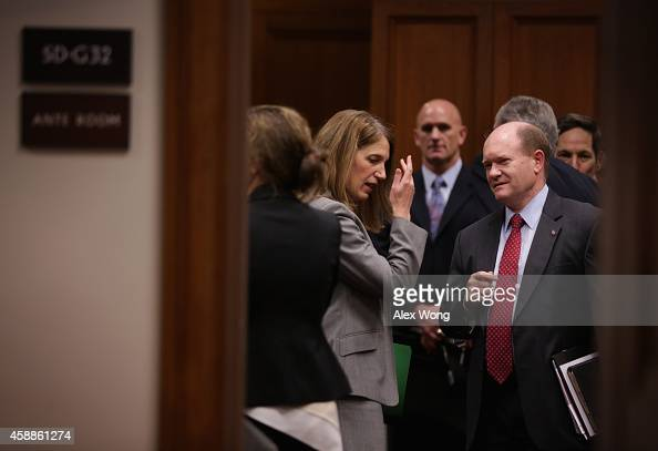 S Secretary of Health and Human Services Sylvia Burwell talks to Sen Chris Coons prior to a hearing before the Senate Appropriations Committee...