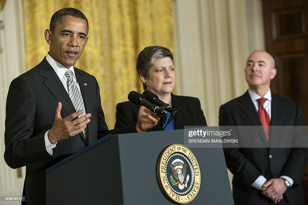 US Secretary of Homeland Security Janet Napolitano (C) and Alejandro Mayorkas (R), Director of United States Citizenship and Immigration Services, listen while US President Barack Obama speaks during a naturalization ceremony in the East Room of the White House on March 25, 2013 in Washington. Obama presided while Napolitano administered the oath of allegiance to active duty service members and civilians officially granting them United States citizenship. AFP PHOTO/Brendan SMIALOWSKI