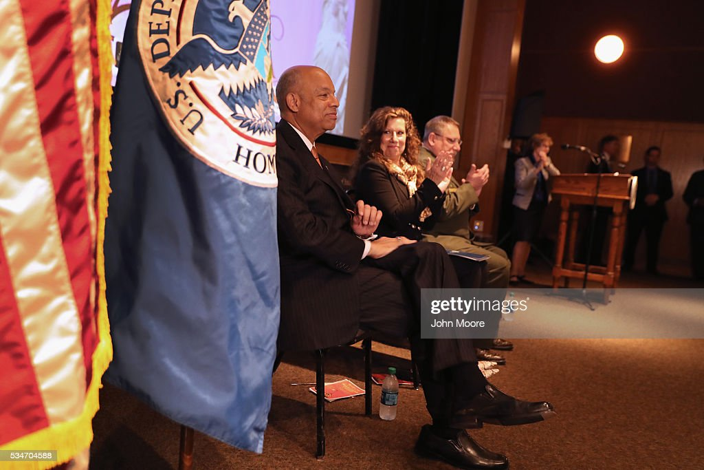 U.S. Secretary of Homeland Security <a gi-track='captionPersonalityLinkClicked' href=/galleries/search?phrase=Jeh+Johnson&family=editorial&specificpeople=5862084 ng-click='$event.stopPropagation()'>Jeh Johnson</a> before a group of immigrants during a naturalization ceremony for new American citizens on Ellis Island on May 27, 2016 in New York City. Johnson administered the oath of citizenship to immigrants from 39 countries on the historic island in New York Harbor where millions of immigrants first arrived to America.