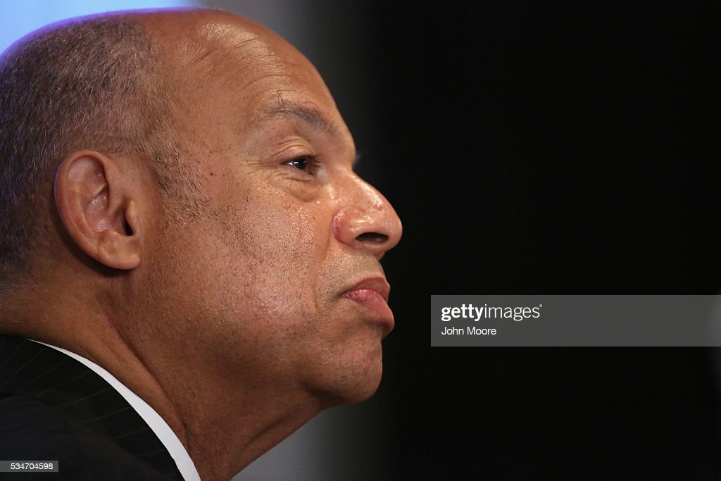 U.S. Secretary of Homeland Security <a gi-track='captionPersonalityLinkClicked' href=/galleries/search?phrase=Jeh+Johnson&family=editorial&specificpeople=5862084 ng-click='$event.stopPropagation()'>Jeh Johnson</a> sits with immigrants during a naturalization ceremony for new American citizens on Ellis Island on May 27, 2016 in New York City. Johnson administered the oath of citizenship to immigrants from 39 countries on the historic island in New York Harbor where millions of immigrants first arrived to America.