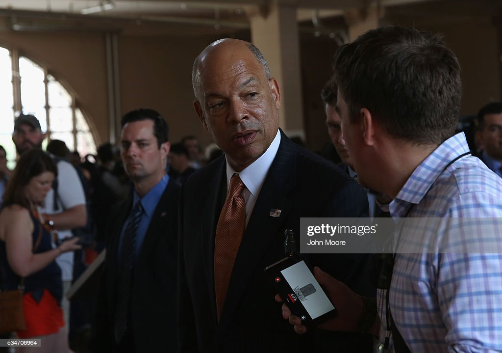 U.S. Secretary of Homeland Security Jeh Johnson speaks to a reporter following a naturalization ceremony for new American citizens on May 27, 2016 in New York City. Johnson administered the oath of citizenship to immigrants from 39 countries on the historic Ellis Island in New York Harbor where millions of immigrants were first processed upon arrival to America.