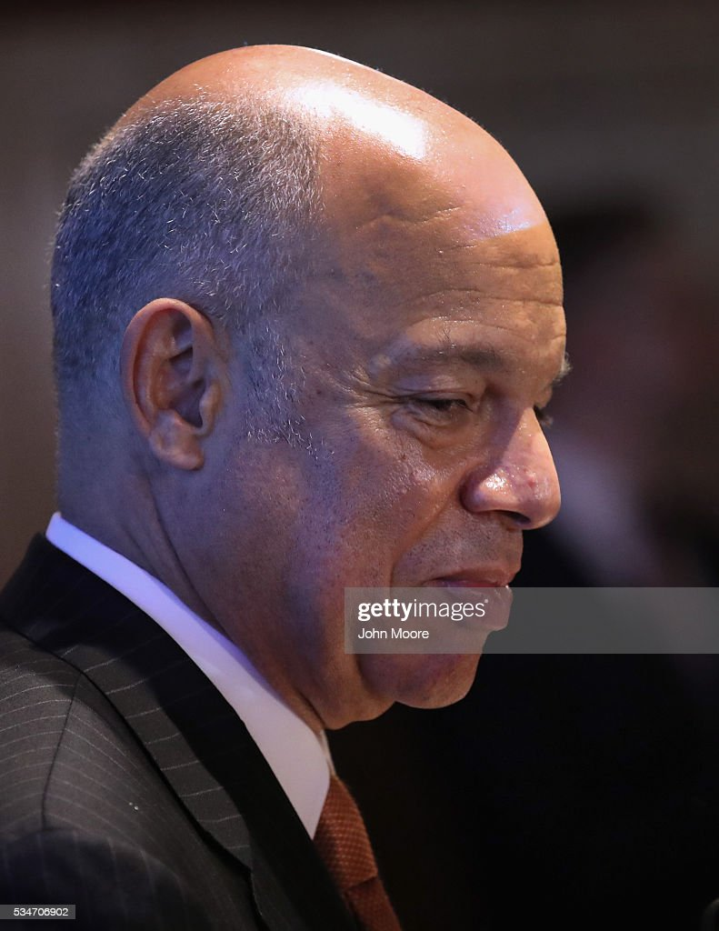 U.S. Secretary of Homeland Security <a gi-track='captionPersonalityLinkClicked' href=/galleries/search?phrase=Jeh+Johnson&family=editorial&specificpeople=5862084 ng-click='$event.stopPropagation()'>Jeh Johnson</a> takes part in a naturalization ceremony for new American citizens on May 27, 2016 in New York City. Johnson administered the oath of citizenship to immigrants from 39 countries on the historic island in New York Harbor where millions of immigrants were first processed upon arrival to America.