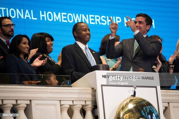 S Secretary of Housing and Urban Development Ben Carson flanked by wife Candy Carson and Thomas Farley president of the NYSE rings the closing bell...