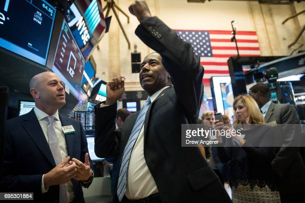S Secretary of Housing and Urban Development Ben Carson gestures as he talks with traders and financial professionals as he tours the floor of the...