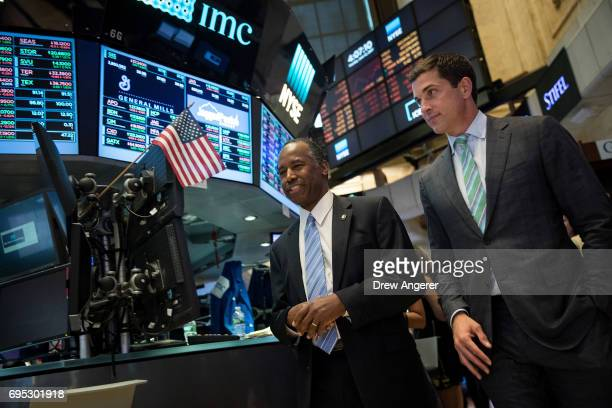 US Secretary of Housing and Urban Development Ben Carson walks with Thomas Farley president of the NYSE as he tours the floor of the New York Stock...
