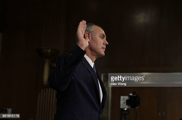 S Secretary of Interior nominee Rep Ryan Zinke is sworn in during his confirmation hearing before Senate Energy and Natural Resources Committee...