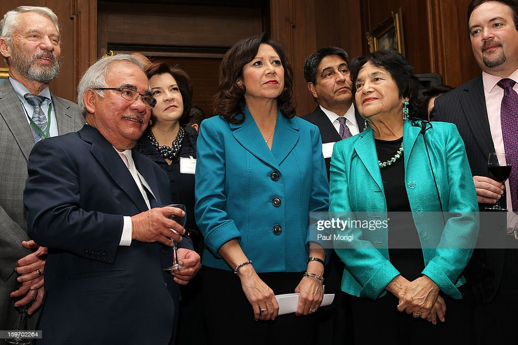 Secretary of Labor <a gi-track='captionPersonalityLinkClicked' href=/galleries/search?phrase=Hilda+Solis&family=editorial&specificpeople=704859 ng-click='$event.stopPropagation()'>Hilda Solis</a> (C) attends a reception to recognize The National Park Service and The American Latino Initiative at the Secretary of the Interior's Suite at the Department of the Interior on January 18, 2013 in Washington, DC.