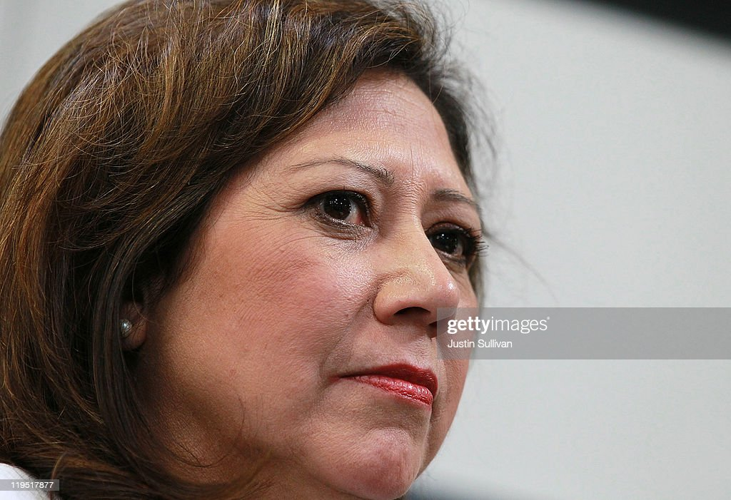 S Secretary of Labor Hilda Solis looks on following a tour of the Santa Clara Valley Transportation Authority hybrid technology training program on...