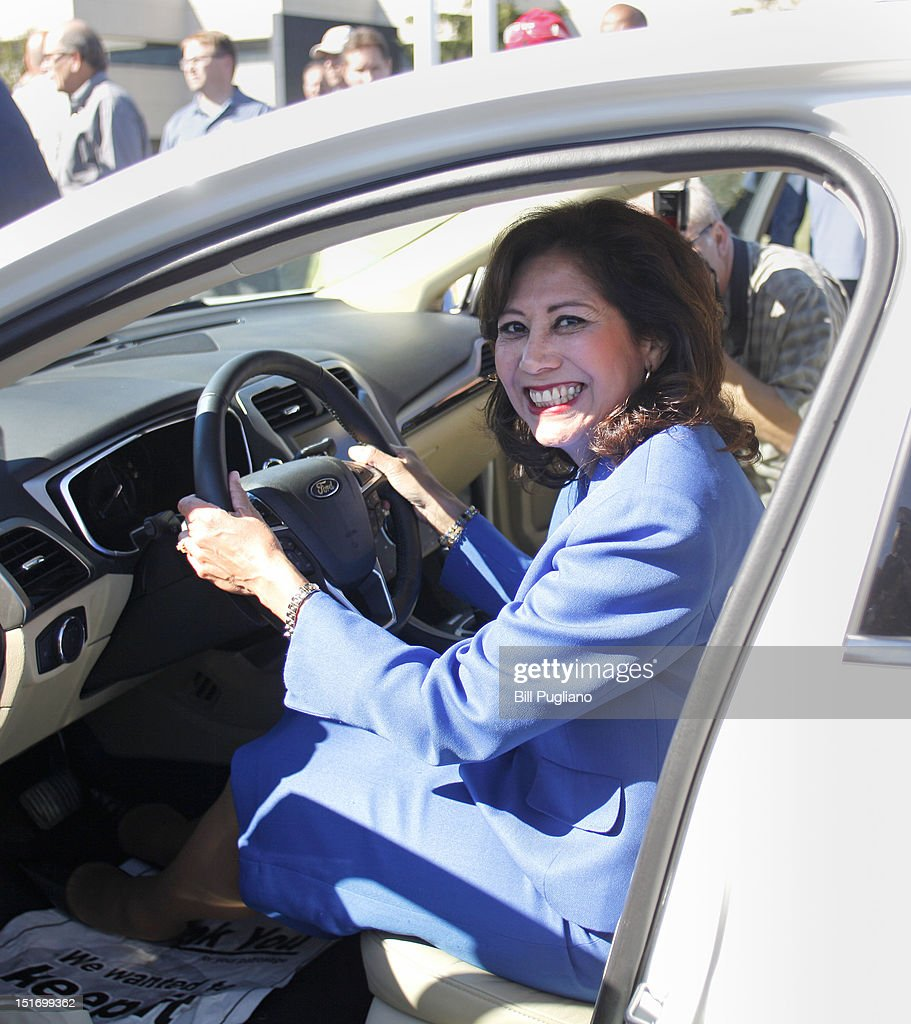 S Secretary of Labor Hilda Solis sits in a 2013 Ford Fusion at an event that celebrates the opening of the new US production line where the 2013 Ford...