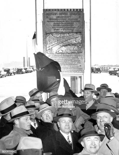 S Secretary of Labor Maurice J Tobin unveils a plaque at the dedication of the new Mystic River Bridge in Boston on Feb 25 1950