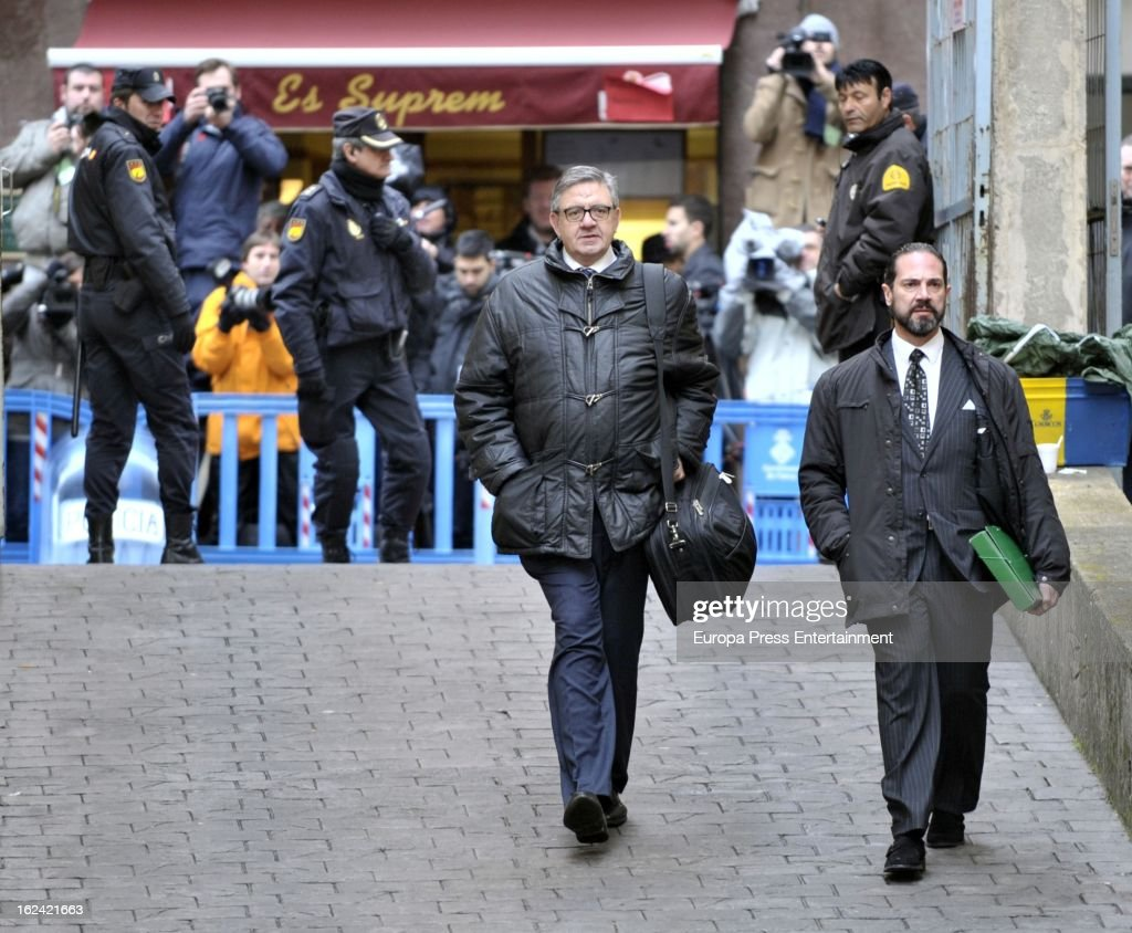 Secretary of Princesses Cristina and Elena, Carlos Garcia Revenga (L) arrives at the courthouse of Palma de Mallorca to give evidence during the during the 'Palma Arena trial' on February 23, 2013 in Palma de Mallorca, Spain. He and the son-in-law of King Juan Carlos of Spain, Inaki Urdangarin, Duke of Palma will testify in court over allegations that they misused millions of euros of public funds, allocated to organise sports and tourism events, during his time a chairman of a non-profit foundation from 2004 to 2006. Public prosecutors suspect the non-profit foundation named 'Instituo Noos', headed by Urdangarin, of siphoning away funds from public contracts awarded to companies run by Urdangarin and his business partners.