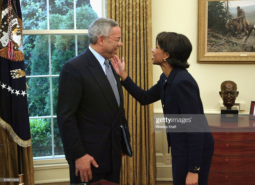 Secretary of State Colin Powell and National Security Advisor Condoleezza Rice talk after a meeting with President George Bush and Islom Karimov, president of Uzbekistan. The leaders discussed human rights and the war on terrorism.