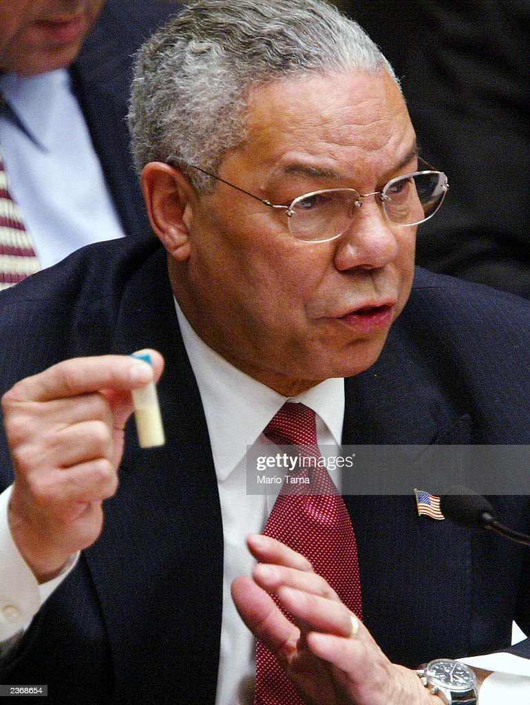 US Secretary of State Colin Powell holds a vial representing the small amount of Anthrax that closed the US Senate last year during his address to...