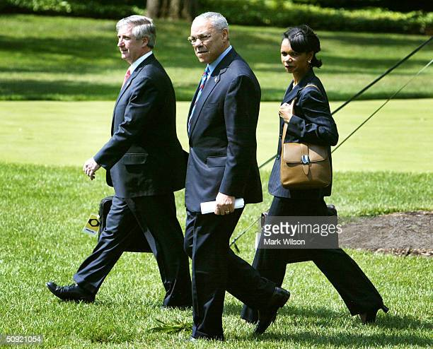 S Secretary of State Colin Powell National Security Advisor Condoleezza Rice and White House Chief of Staff Andy Card walk along the South Lawn...