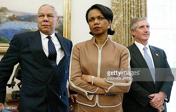 Secretary of State Colin Powell National Security Advisor Condoleezza Rice and White House Chief of Staff Andrew Card look on as US President George...