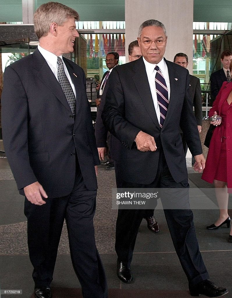 Secretary of State Colin Powell walks Canadian Foriegn Minister John Manley 21 September 2001 at the State Department in Washington DC after a...