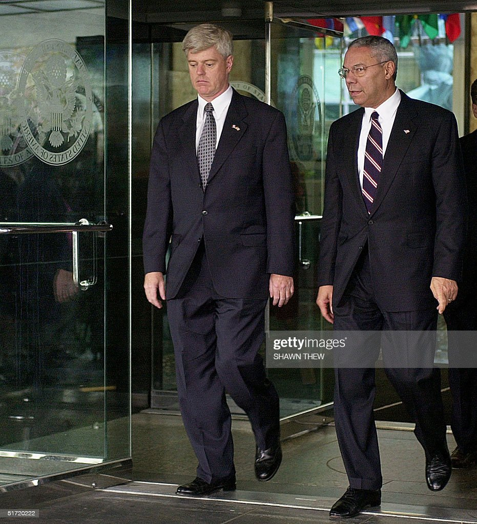 Secretary of State Colin Powell walks to apress cnference next to Canadian Foreign Minister John Manley 21 September 2001 after their meeting to...
